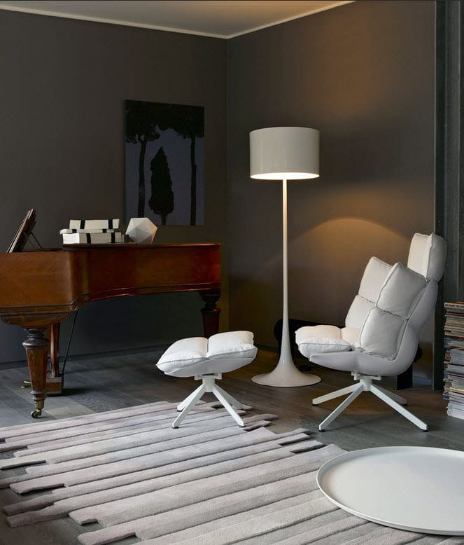 Contemporary fireside chair / fabric / leather / steel - HUSK ...