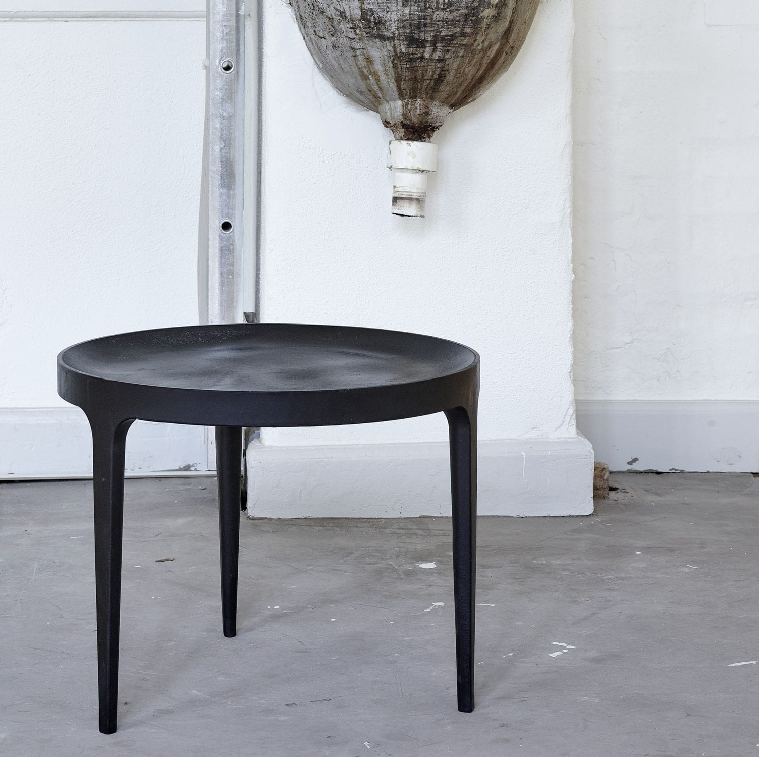 contemporary coffee table / cast aluminum / round / black - ghost