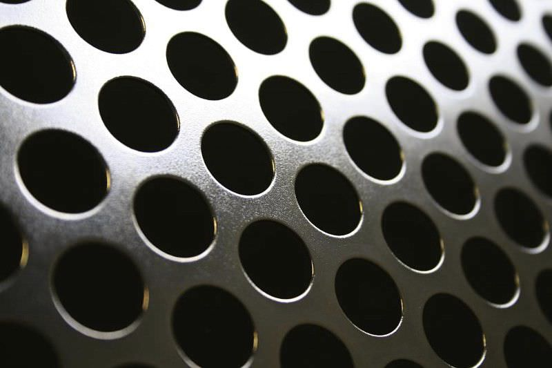 perforated sheet metal decorative facade with round perforations rmig - Decorative Sheet Metal