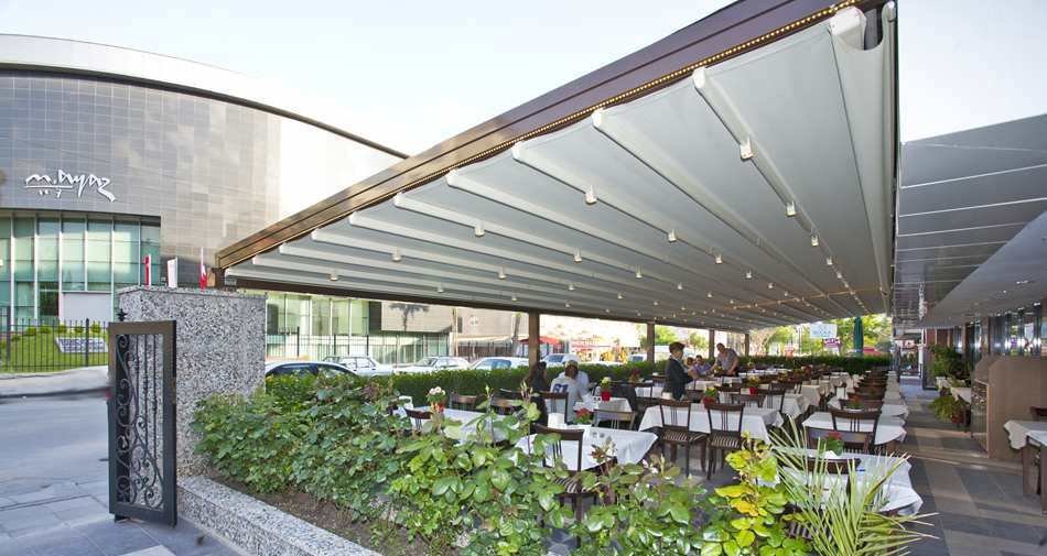 wall-mounted pergola / aluminum / stainless steel / fabric sliding canopy -  NOVO - Wall-mounted Pergola / Aluminum / Stainless Steel / Fabric Sliding