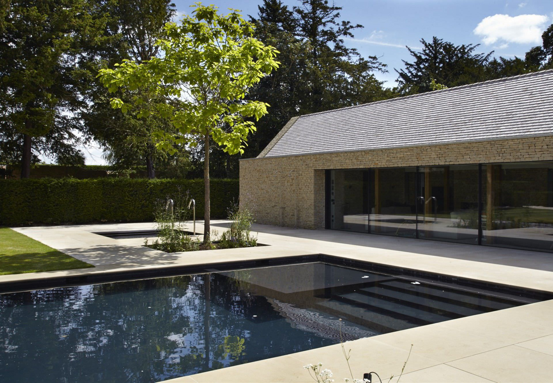 In-ground swimming pool / stone / with cover / outdoor ...