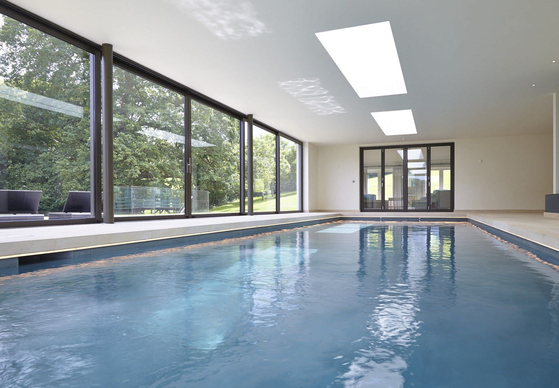 in-ground swimming pool / limestone / indoor - cotswolds - guncast