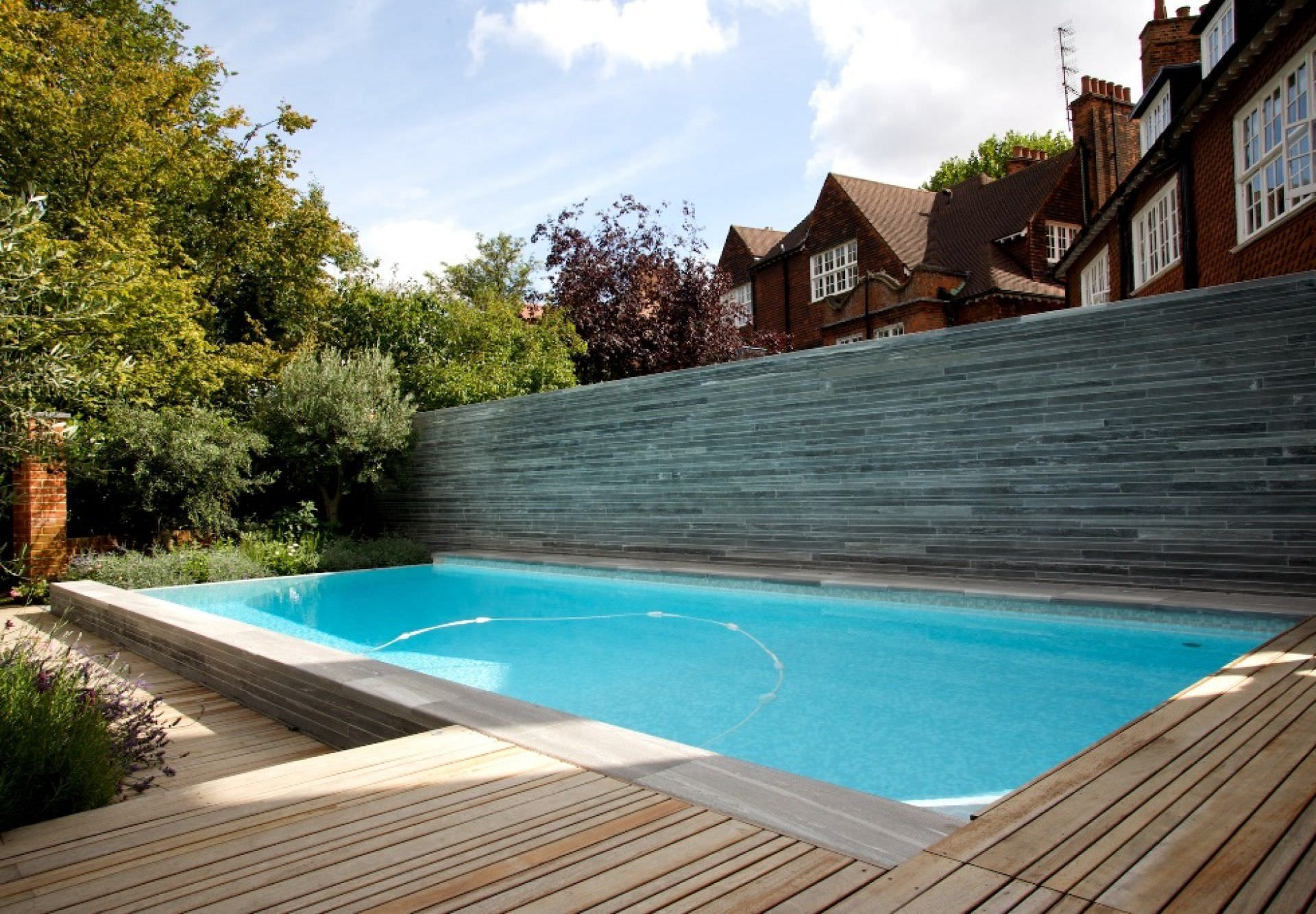 Inground swimming pool concrete overflow outdoor