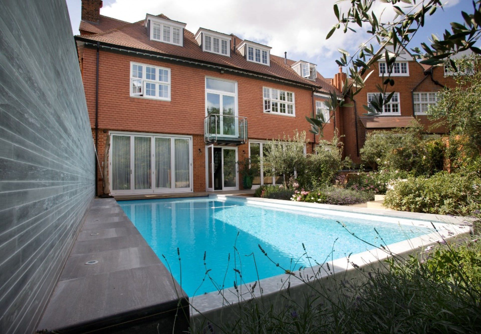 in ground swimming pool concrete overflow outdoor hampstead guncast swimming pools - Outdoor House Pools