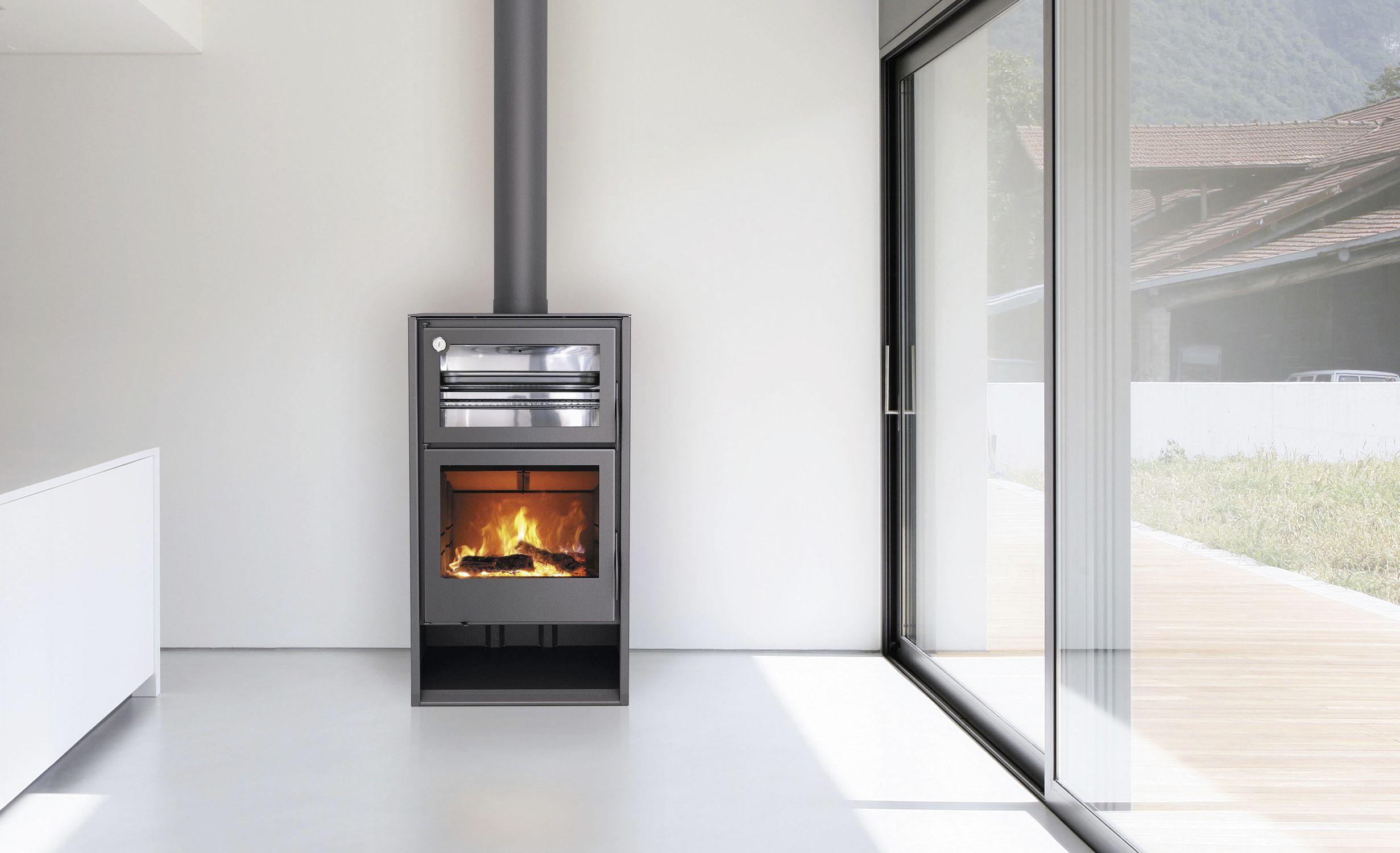 Wood heating stove / contemporary / corner / metal - ATLAS - Carbel