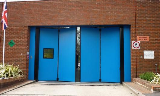 Folding industrial door / metal / emergency exit / automatic ...
