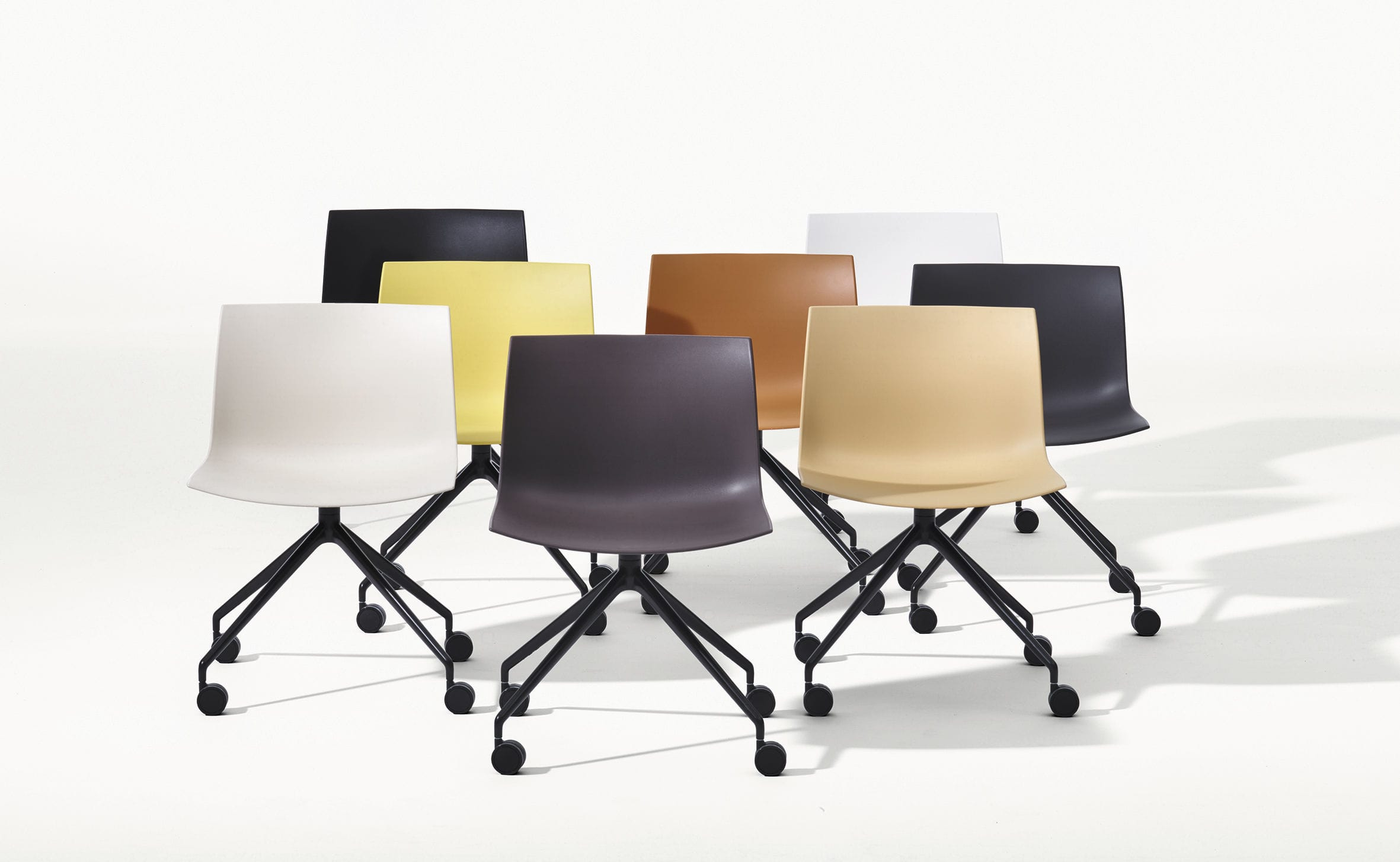 Contemporary chair upholstered on casters star base CATIFA