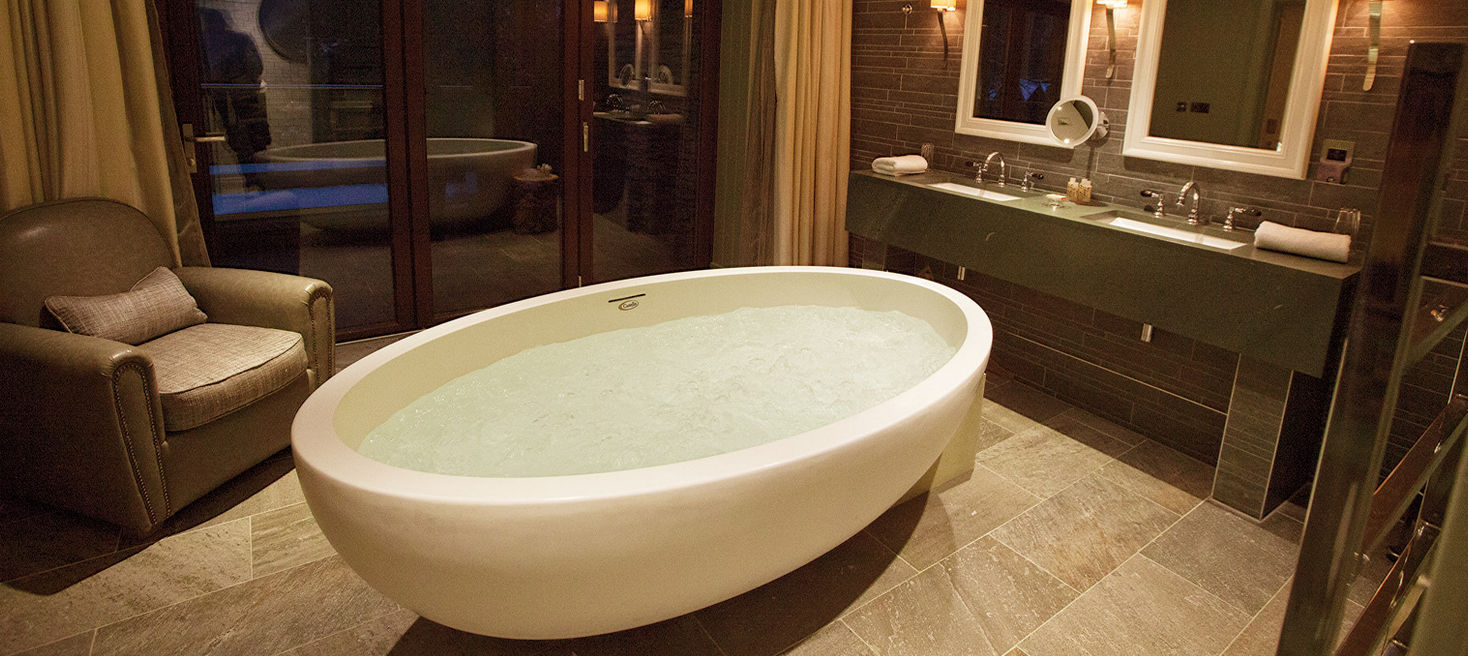 Freestanding bathtub / oval / composite / double - IMPERIA ...