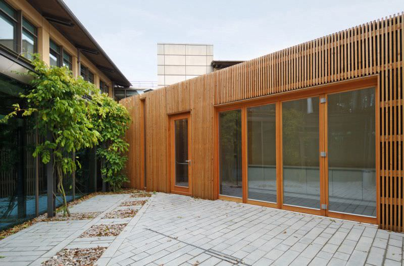Prefab building / for offices / solid wood / wooden frame - TRUST ...