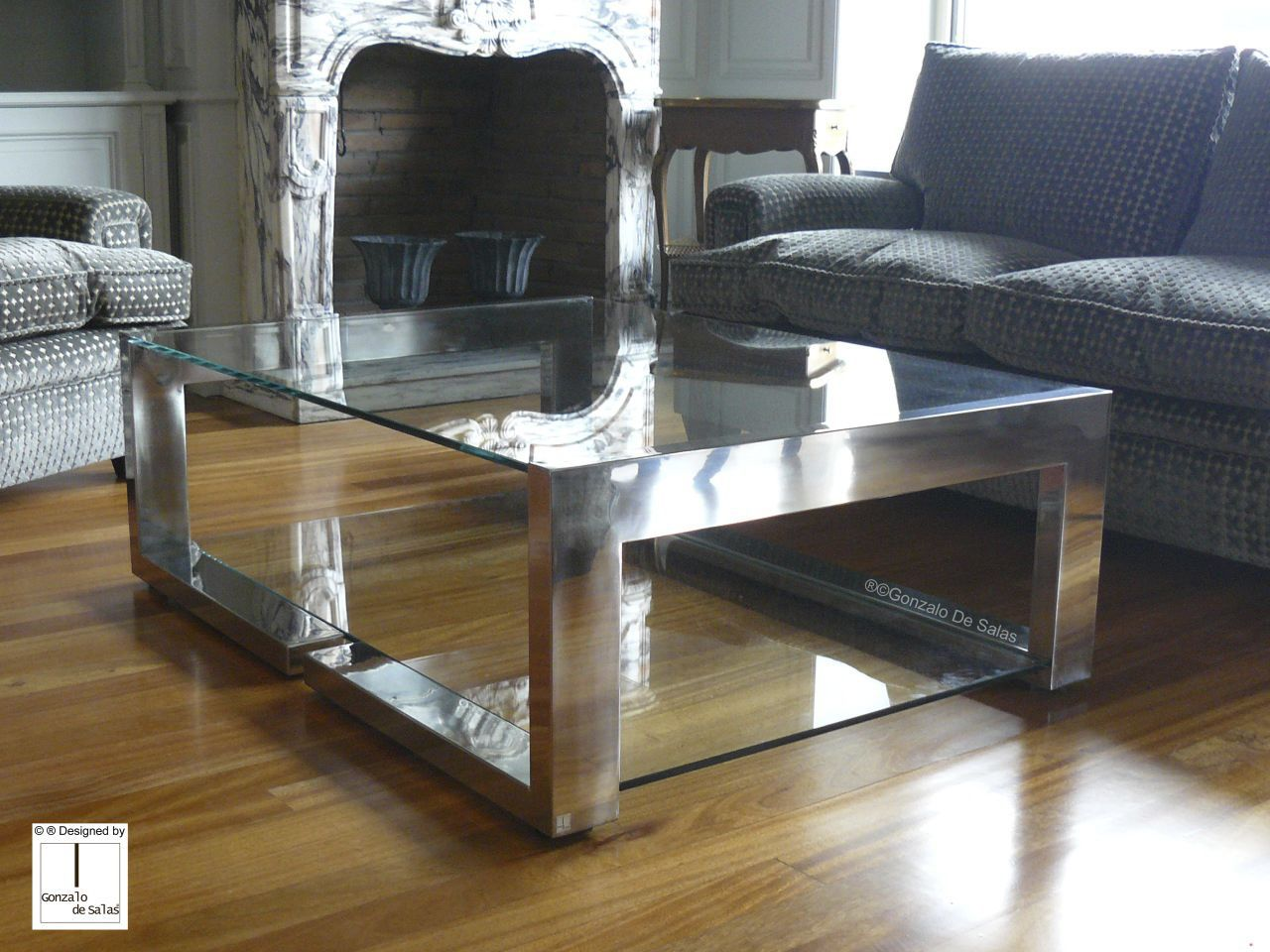 contemporary coffee table / glass / polished stainless steel