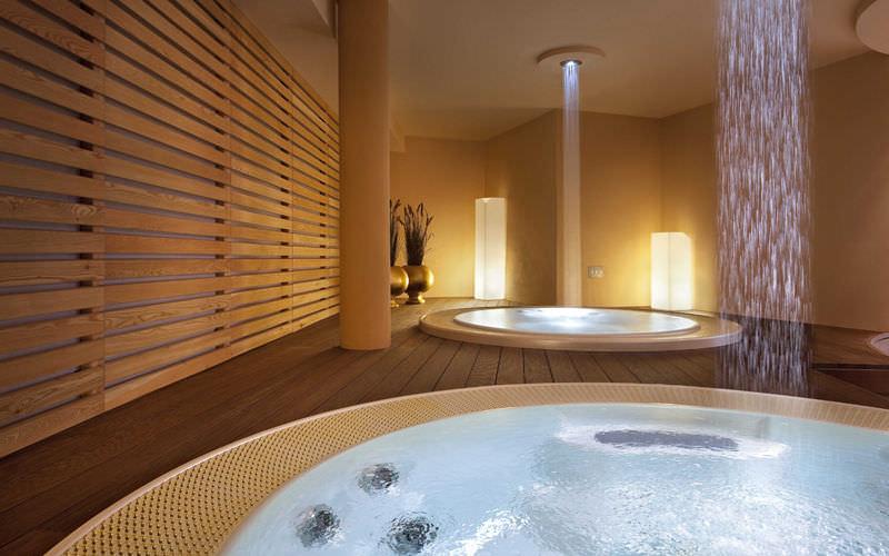 Built-in bathtub / oval / fiberglass / ceramic - Starpool