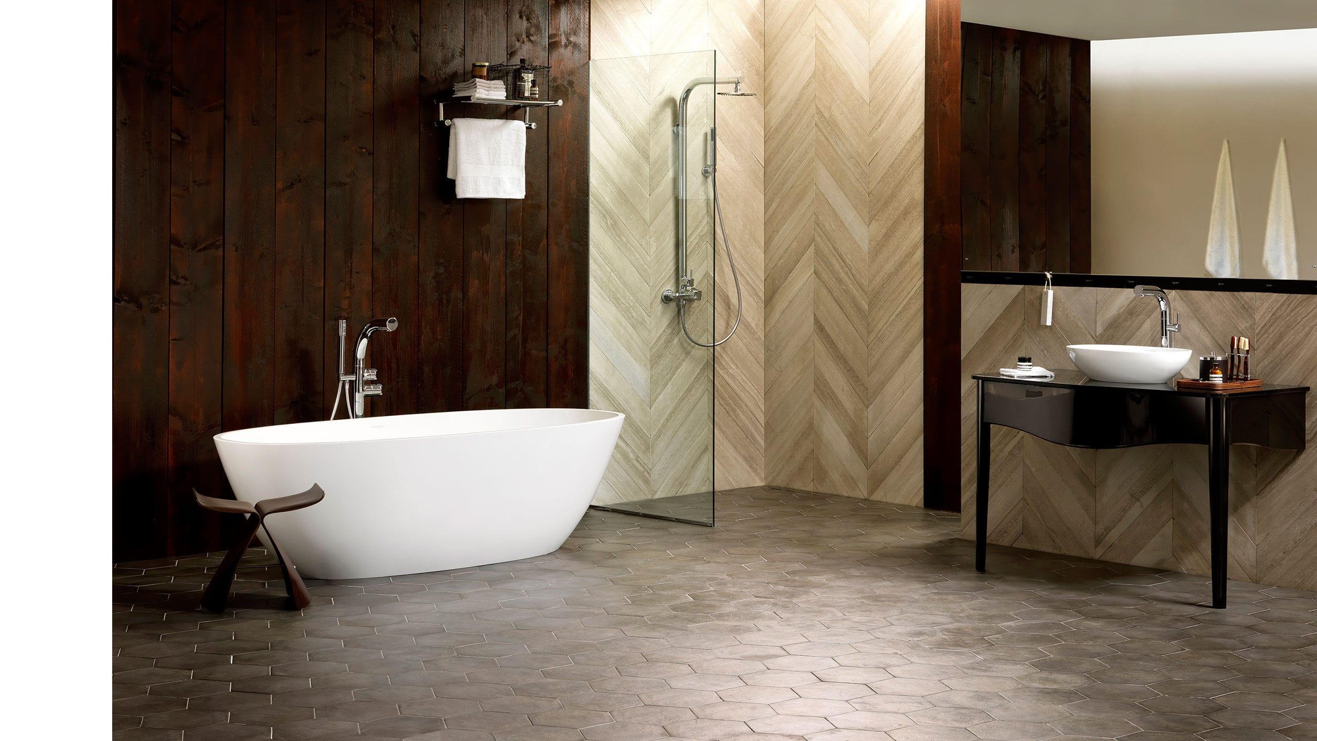 Freestanding bathtub / oval / resin / limestone - TERRASSA ...