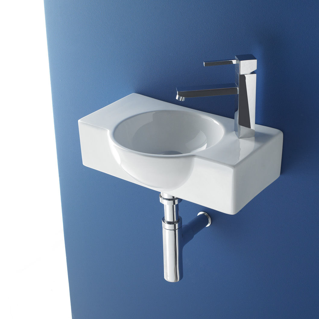 Wall-mounted washbasin / porcelain / contemporary / with counter ...