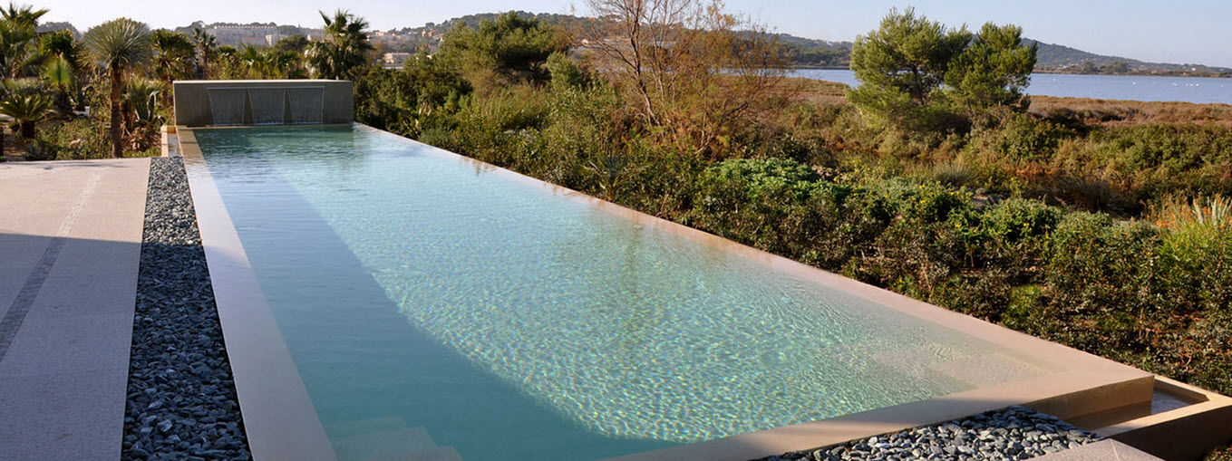 Inground concrete swimming pool with perimeter overflow (lap pool ...
