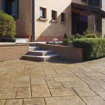 Stamped concrete floor covering / for public spaces / textured / paver effect