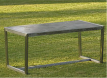 Contemporary table / fiber-reinforced concrete / stainless steel / rectangular