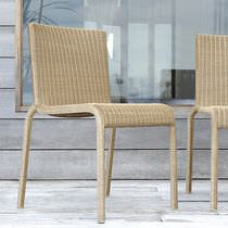 Contemporary chair / stackable / resin wicker / garden