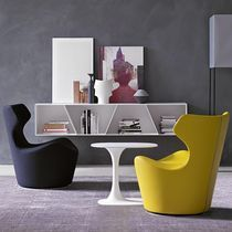 Contemporary fireside chair / leather / fabric / indoor