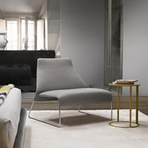Contemporary fireside chair / steel / leather / fabric
