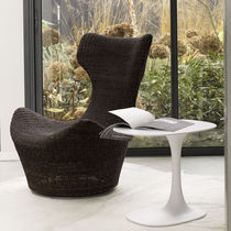 Contemporary armchair / abaca fiber / wing / with footrest