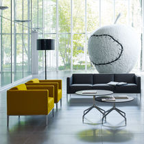 Contemporary armchair / leather / fabric / with footrest