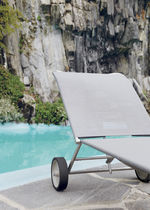 Contemporary sun lounger / stainless steel / in polyester mesh / on casters