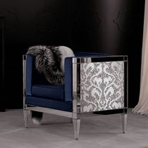 Contemporary armchair / fabric / metal / bridge