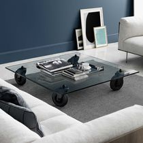 Contemporary coffee table / glass / square / on casters