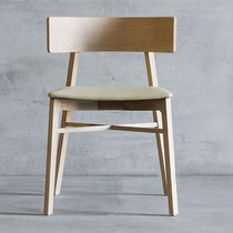 Contemporary chair / upholstered / fabric / solid wood