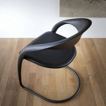 Contemporary chair / with armrests / upholstered / cantilever