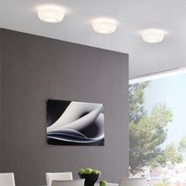 Contemporary ceiling light / round / chromed metal / fluorescent