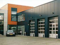 Sectional industrial door / metal / automatic / glazed