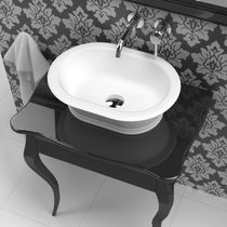 Countertop washbasin / oval / Solid Surface / traditional