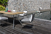 Contemporary dining table / teak / HPL / stainless steel