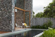 Contemporary armchair / sled base / aluminium / garden