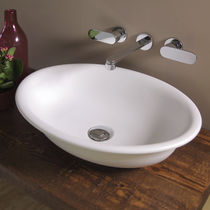 Countertop washbasin / oval / ceramic / traditional