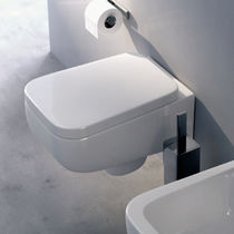 Wall-hung toilet / ceramic / by Rodolfo Dordoni