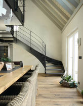 Circular staircase / stainless steel steps / metal frame / without risers
