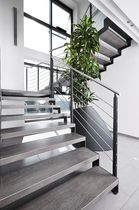 Half-turn staircase / stone steps / steel frame / without risers