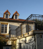 Wrought iron railing / with bars / outdoor / for stairs