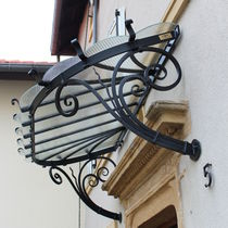 Entrance canopy / glass / wrought iron / precast