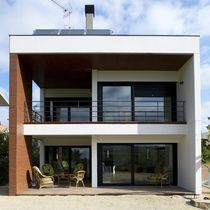 Prefab house / contemporary / concrete / energy-efficient