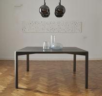 Contemporary dining table / brass / basalt / rectangular