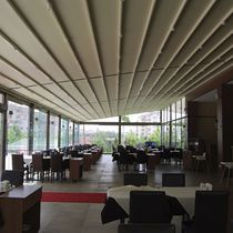 Wall-mounted pergola / metal / with sliding canopy / commercial