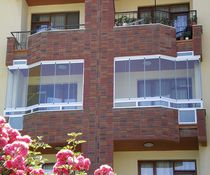 Sliding and stacking patio door / aluminum / double-glazed