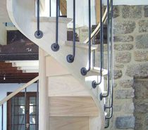 Spiral staircase / wooden steps / wooden frame / with risers
