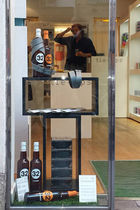 Wall-mounted display rack / glass / for shops