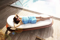 Contemporary lounge chair / water-repellent fabric / teak / mahogany