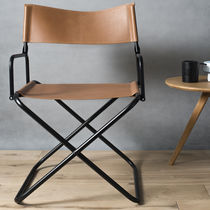 Contemporary chair / leather / with footrest / folding