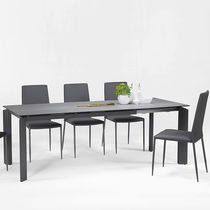 Contemporary table / tempered glass / stainless steel / lacquered steel